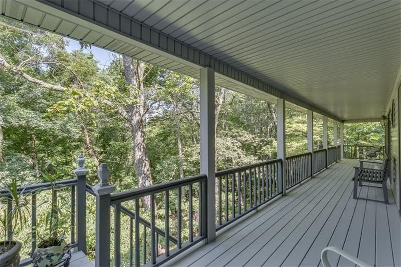 wrap-around porch at 823 N Duffer Drive in Bent Tree (listing photo)