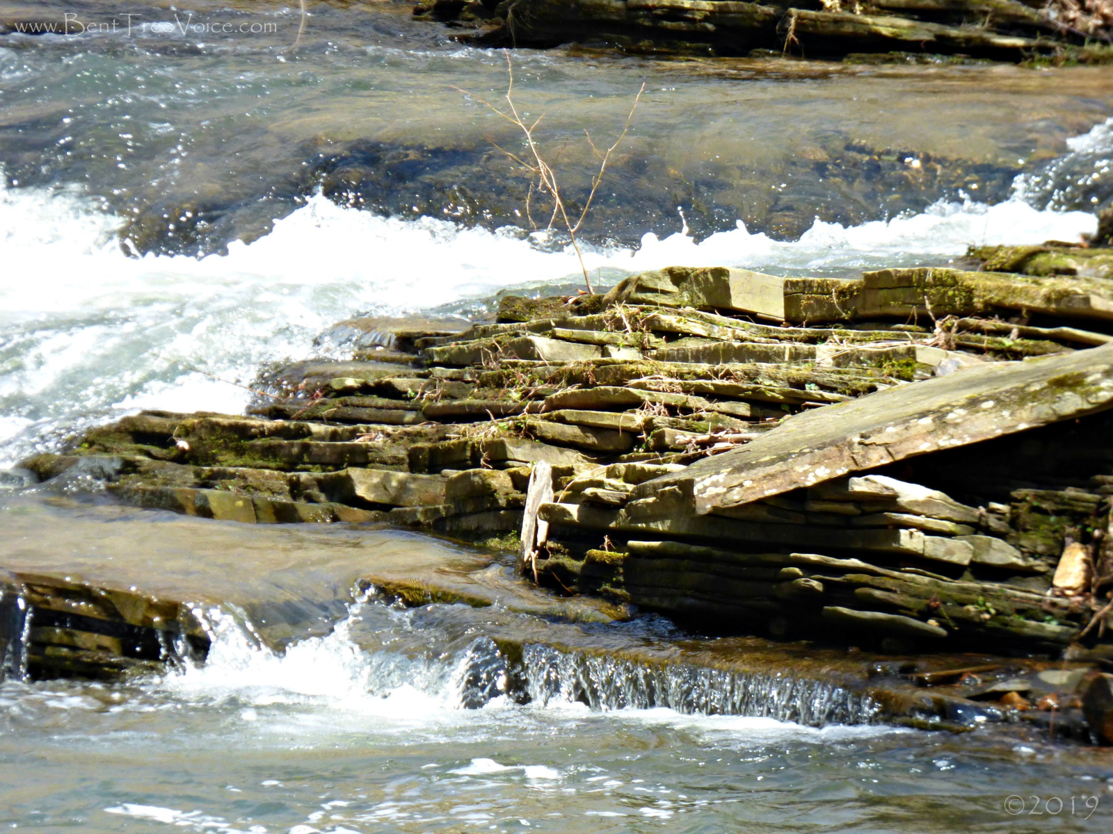 March 7, 2019 - Layers of rocks at creek's edge in Bent Tree