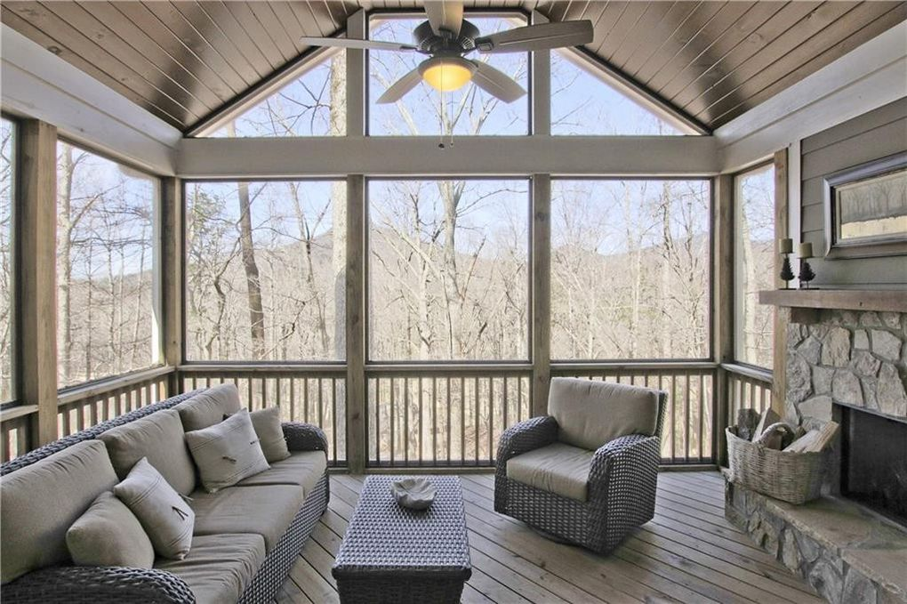 Screened porch with stone fireplace, 236 Crippled Oak Trail in Bent Tree (agent's listing photo)